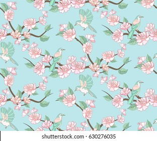 Spring apple or peach tree blossom seamless pattern with flying birds on blue sky background