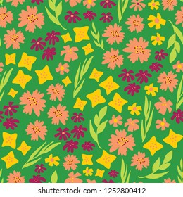 Spring flowers seamless vector repeat pattern. Hand drawn florals background green, yellow, pink. Scandinavian doodle flat ditsy flowers. For spring, summer, easter, fabric, paper, dress, paper