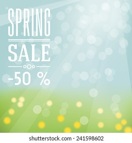 Spring sale label - sky and grass with flowers on background and white flat label.