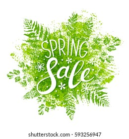 Spring sale message on green leaves background