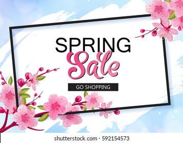 Spring sale vector banner design with flowers and frame. Cherry blossoms and blue sky background.