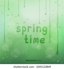 Spring time text on green blurry rain bokeh wet background. Nature blurred spring or summer abstract water bubbles design backdrop. Agriculture rainy drops flow wallpaper with message