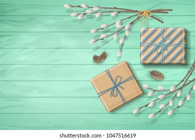 Spring top view wooden background with a gifts, feathers and pussy willow branches