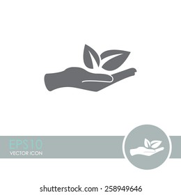Sprout in a hand sign of environmental protection vector icon.