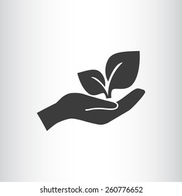 sprout in a hand sign of environmental protection, web icon.