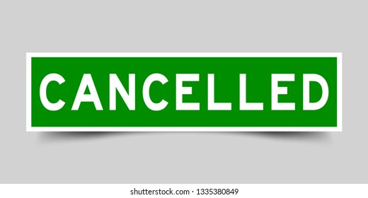 Square green color sticker with word cancelled on gray background