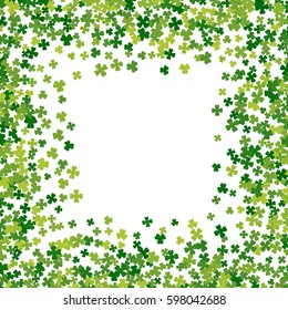 Square green frame, border or background of random scatter clover leaves. Elegant St. Patricks day design for festive banner, greeting card, postcard, flyer. Vector illustration.