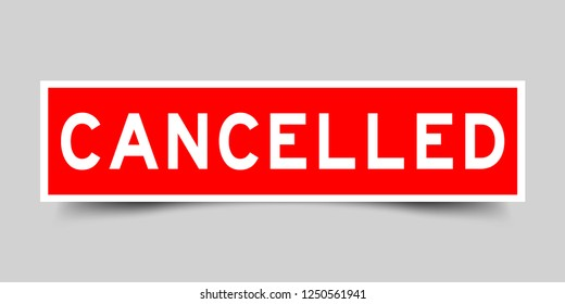 Square red color sticker with word cancelled on gray background