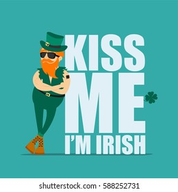 St. Patrick's Day greeting card, banner, poster, print on a t-shirt. Leprechaun hipster and an inscription kiss me I am Irish. Vector illustration