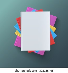 Stack of blank books, top view. Various blank color books on dark background for your desing and presentation.