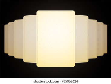 A stack of a deck of several cards spread out on the table with a panorama. The blank, the old paper is yellow