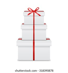 Stack of three realistic white gift boxes with red ribbon and bow isolated on white background. Vector EPS10 illustration.