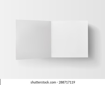 Stack of white stickers with the open page. Top view. Isolated on white.