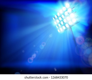Stadium illuminated by floodlights. Abstract vector illustration.