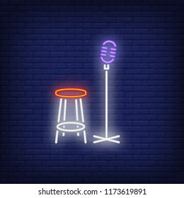 Stage neon icon. Mic and chair on brick wall background. Show concept. Vector illustration can be used for neon signs, advertising, stand up show, music contest