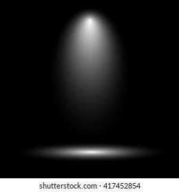 Stage spotlight on dark background