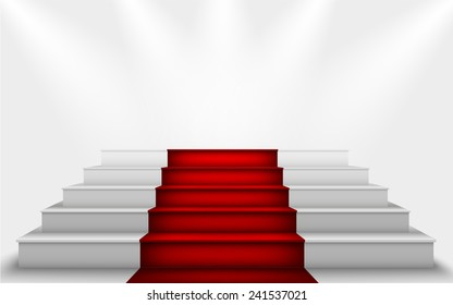 stairs to the podium with a red carpet