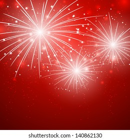 Starry fireworks on red background