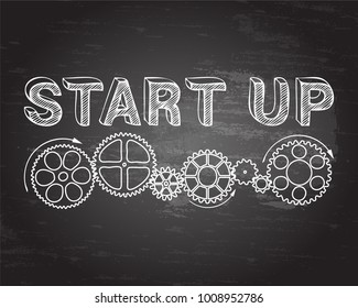Start up text with gear wheels hand drawn on blackboard background