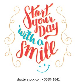Start your day with a smile. Brush calligraphy, motivational handwritten text isolated on white background for cards, wallprint, t-shirt or poster