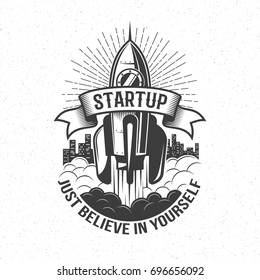 Startup retro logo - rocket launch in the sky with word on ribbon and believe in yourself motto.  Vintage emblem with spaceship.