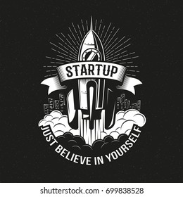 Startup vintage logo with a rocket taking off over the city on a black background. Vector illustration.