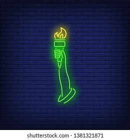 Statue of Liberty arm neon sign. Green hand, torch, flame, 4th of July. Vector illustration in neon style for festive independence day banners, light billboards, posters