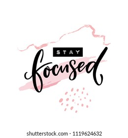 Stay focused inscription. Motivational quote, handwritten calligraphy and embossed tape text on abstract pink brush strokes. Poster print design