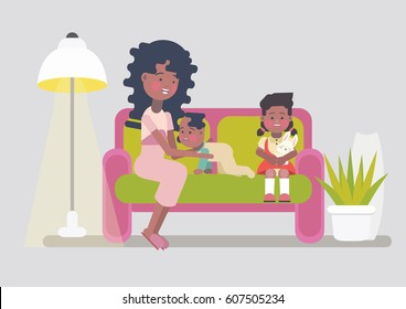 Stay at home afro american mom playing with her two children