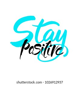 Stay positive inscription. Greeting card with calligraphy. Hand drawn brush lettering design. Photo overlay. Typography for banner, poster or apparel design. Isolated vector element.