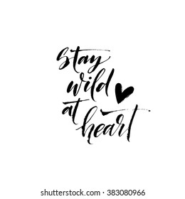 Stay wild at heart card. Hand drawn lettering background. Ink illustration. Modern brush calligraphy. Isolated on white background.