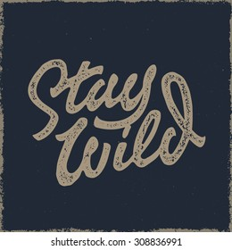 Stay Wild Old school Hand Drawn t Shirt Fashion Print Apparel Graphics. Retro Typographic Custom Quote Design. Textured Stamp effect. Vintage Americana Style Original Lettering. Vector Illustration.
