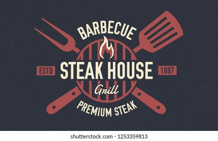 Steak House - vintage logo concept. Emblem of Steak House, barbecue restaurant with barbecue grill, spatula and grill fork. Retro poster for shop, restaurant. Vector Steak House logo template.