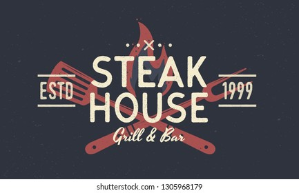 Steak House vintage logo, poster. Logo template with spatula and grill fork. Design of poster for Steakhouse, barbecue, restaurant. Vector emblem template.