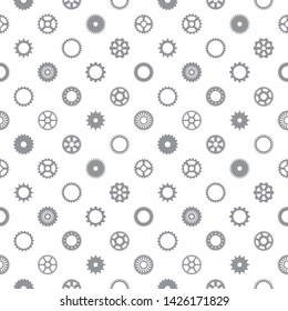 Steampunk, industrial seamless vector pattern. Various steel, metal, iron spur or ring gears silhouettes, icons with pinion edge, cogwheel, flywheel. Mechanical, tech background, regular texture.