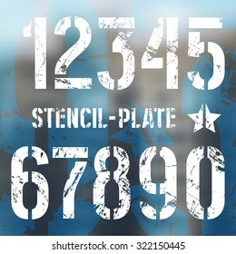Stencil-plate numbers in military style with shabby texture. Bold face. Print on blurred background