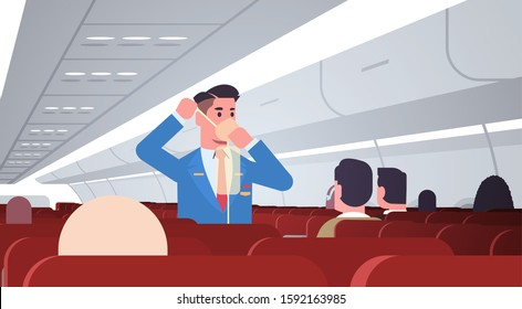 steward explaining for passengers how to use oxygen mask in emergency situation male flight attendant safety demonstration concept modern airplane board interior horizontal vector illustration
