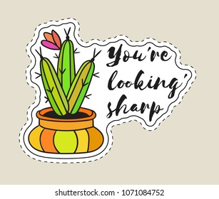 Sticker with cactus in pot with the inscription You are looking sharp. Colored funny cute patch with black contour. Design for tag, label, sticker, postcard, greeting card. Vector illustration.