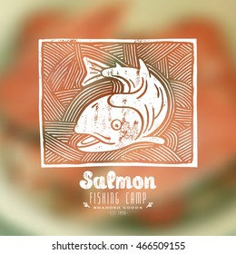 Stock vector linocut with a picture of salmon. White print on blurred background