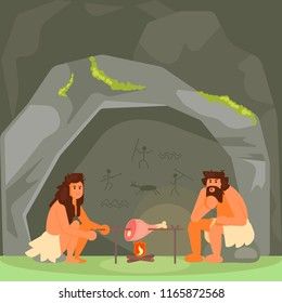 Stone age family couple cooking meat on open fire next to their cave home. Vector flat style design illustration.