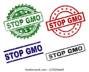 STOP GMO seal prints with corroded texture. Black, green,red,blue vector rubber prints of STOP GMO tag with corroded texture. Rubber seals with circle, rectangle, medallion shapes.