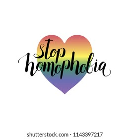 'Stop Homofobia' lettering. Vector illustration with LGBT movement rainbow flag in heart shape and Stop Homophobia slogan.