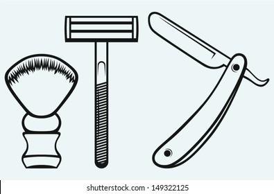 Straight razor and shaving brush isolated on blue background
