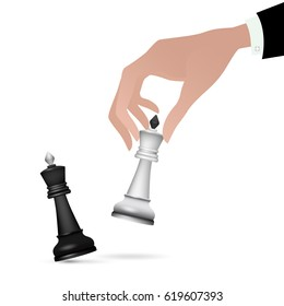 Strategist holding in hand chess figure black king