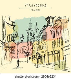 Street in old town center of Strasbourg, Bas Rhin, France. Historical buildings, church, shops and lights. Bold freehand drawing with black charcoal on paper. Travel sketch postcard design template