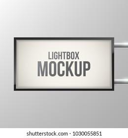 Street sign hanging mounted on the wall. Illuminated lightbox. Restaurant, hotel, night club logo presentation. Cinema or theater light box frame. Rectangle light box.