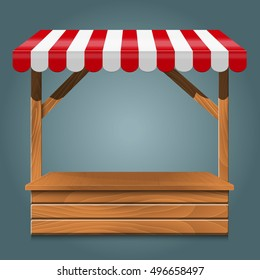 Street stall with red awning and wooden rack.