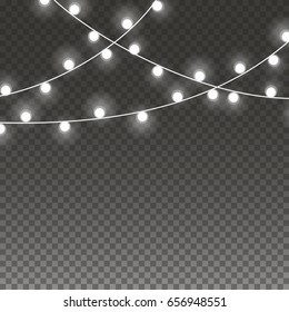 String light Christmas garlands isolated on transparent background. Vector white festive string bulbs. Glowing lights decorations garlands set for Xmas, New Year Holiday greeting card design.