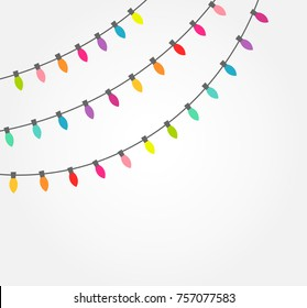 Strings of colorful decorative Christmas lights. Vector illustration