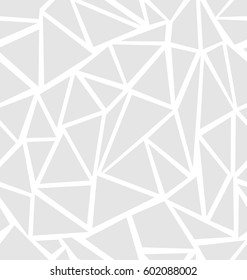 Structure of triangles in light gray a seamless pattern on a white background.
